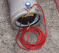 Close image of concrete pipe fitted with MGF Pipe Stopper