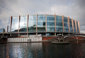 Outside view of Barclaycard Arena behind the river in 2014