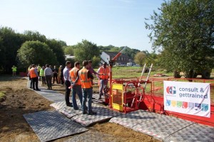 Business men in high vis vests looking at MGF Edgesafe products in the ground at an event