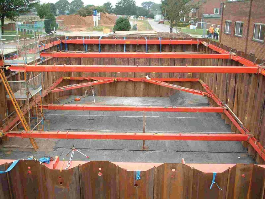 Excavation with red MGF sheets and braces for water treatment works at Hurleston