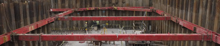 Inside look at MGF sheets and braces supporting a large excavation