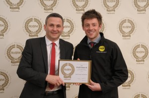 Posed photo of two men holding a RoSPA Gold Award certification