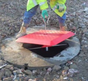 MGF manhole ring lifter in use on a construction site with red Edgesafe equipment