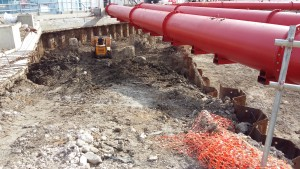 Close look at an excavation in progress at a work site stabilised with large MGF temporary works