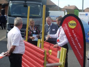 Four people looking at and discussing a MGF GRiPSHORE product at an event