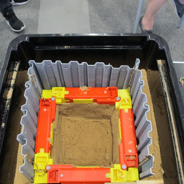 Above view of a demonstration of a cofferdam using miniature MGF products