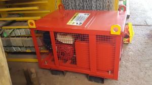Red MGF petrol motorised pump on the floor in a warehouse