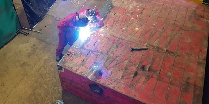 Students welding at MGF