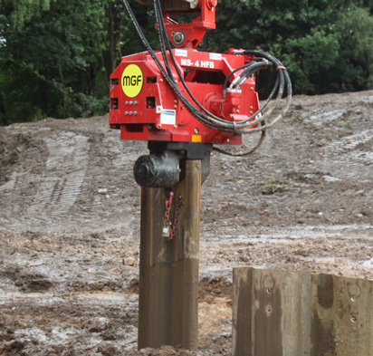 Red MGF Piling Hammer pictured on site in use