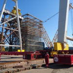 Cranes on a major project site being installed with the help of MGF props