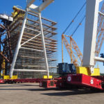 Close view of MGF props helping to place gantry cranes on a major project site