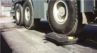 MGF Lifting Bag on the ground underneath the wheel of a large vehicle