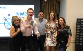 Group of smiling MGF employees celebrating award win