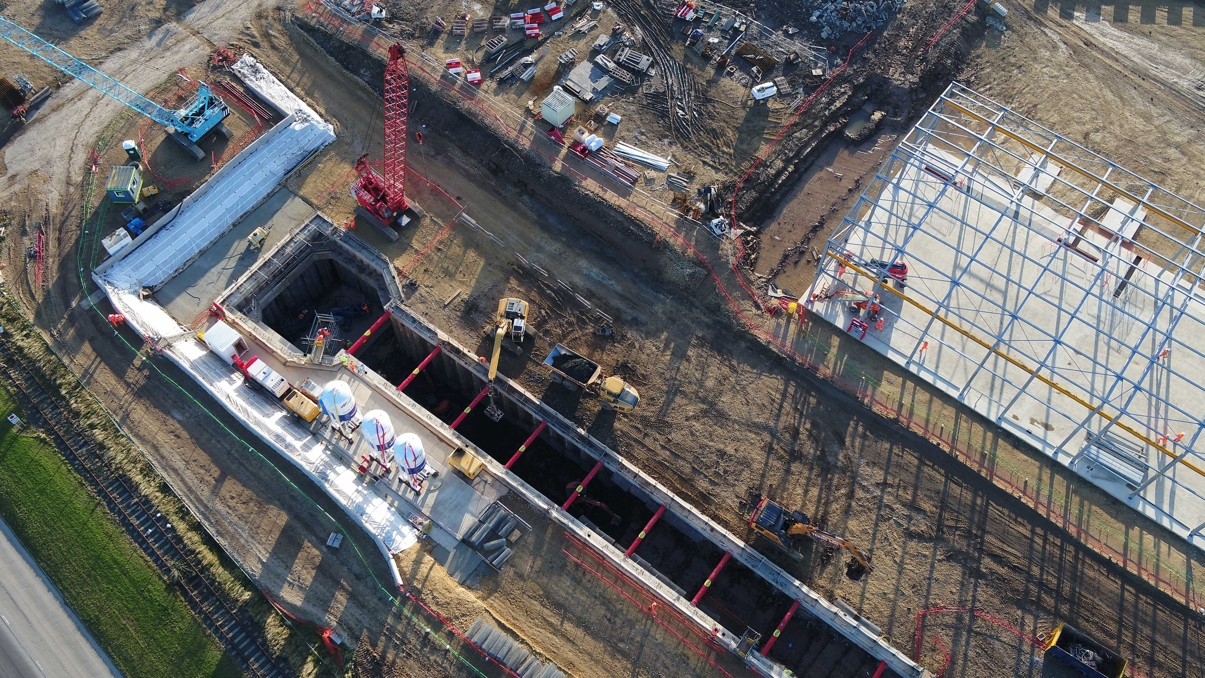 Aerial footage of major work site with large excavation