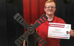 MGF Apprentice Kevin Crane with his fabricated windmill competition entry