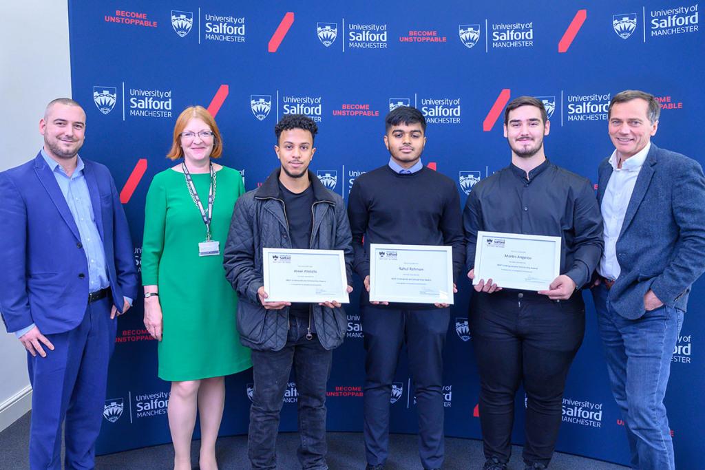 Students holding scholarship awards