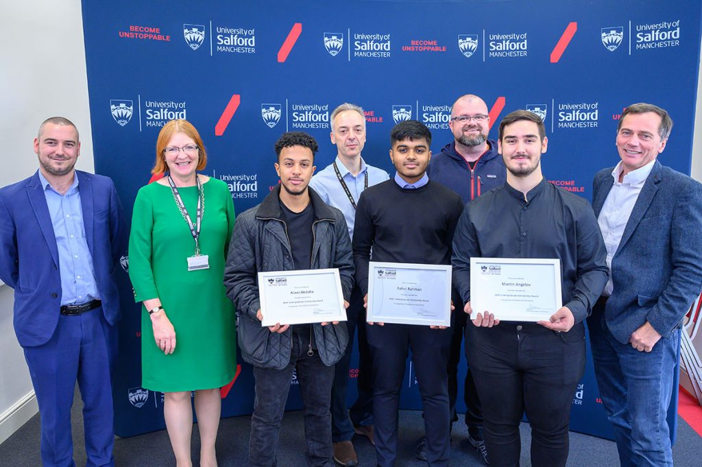 University of Salford students posing with scholarship awards