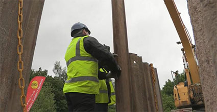 Construction worker helping to install MGF kit onsite