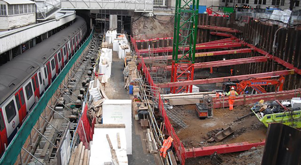 Train in the London underground next to an excavation