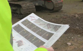 Man holding an installation sheet for MGF kit
