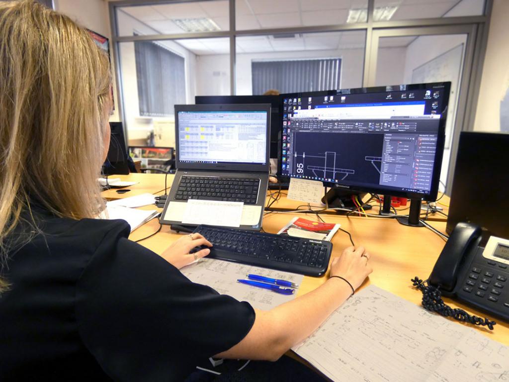 Girl working on computer screens